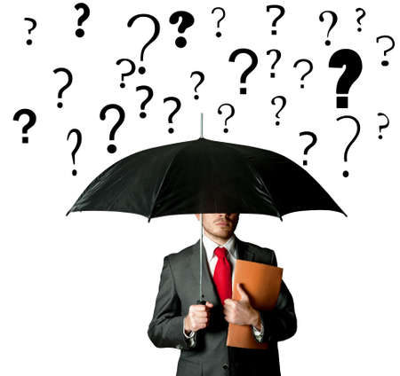 doubt: A businbessman protects himself by doubts with umbrella