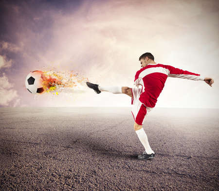 Power of a football player with fire in the ball photo