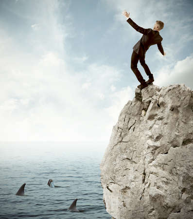 Concept of risk in business with falling businessman