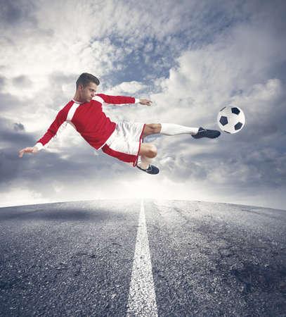 A young footballer play in the street Standard-Bild