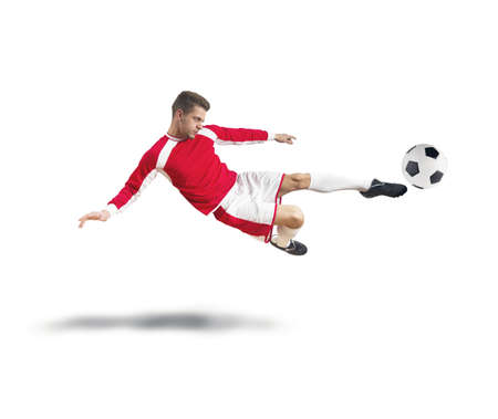 A young footballer play on white background