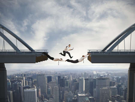 overcome: Concept of difficulty in business and teamwork Stock Photo