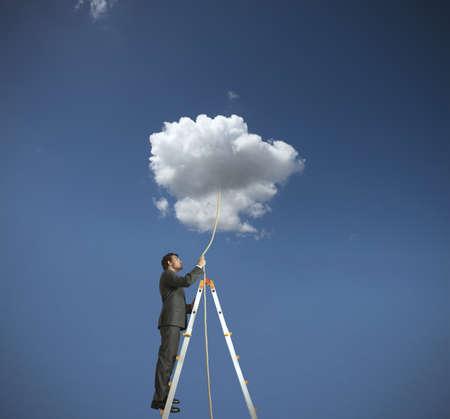day dreams: Concept of man grabbing a dream