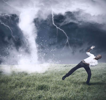 scared man: Concept of crisis with storm and tornado Stock Photo