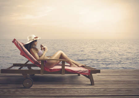 Woman relaxing on a beach during sunset Stock Photo - 19320441
