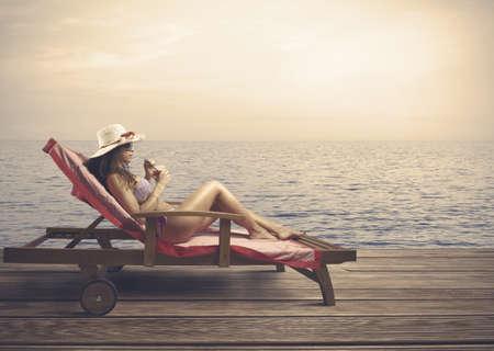 woman beach: Woman relaxing on a beach during sunset