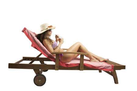 Woman relaxing on a beach on white background Stock Photo - 19318247