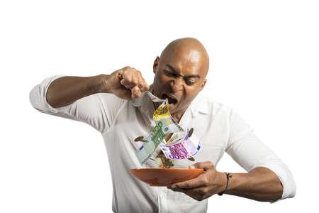Concept of businessman that eats the money