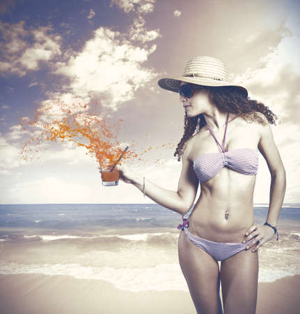 Girl with drink in a beach photo