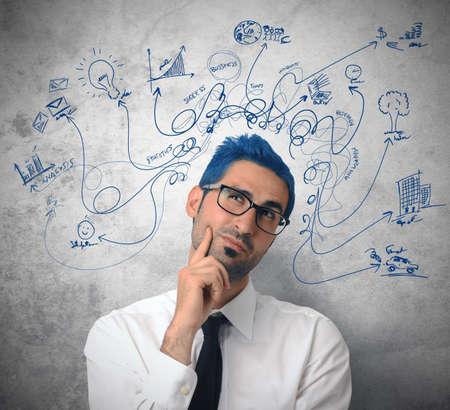 change concept: Empresario pensamiento creativo con el s�mbolo de negocio
