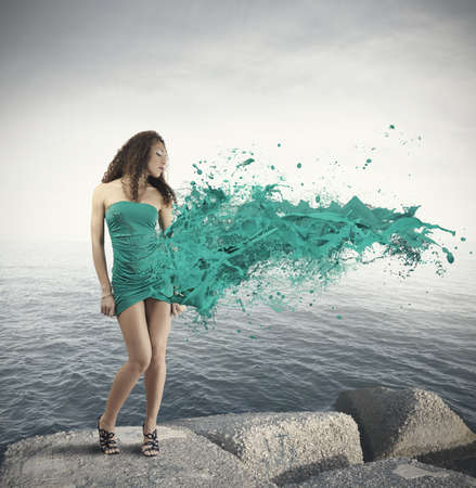 model art: Creative fashion girl with motion effect at the sea