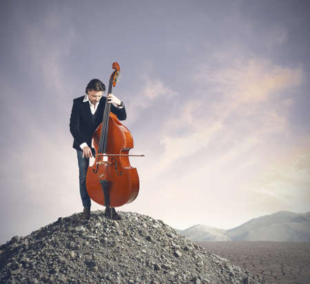 solo violinist: Musician playing bass at the desert