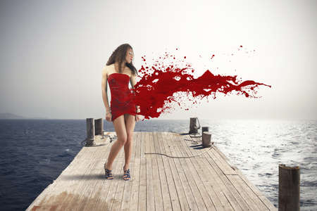 Creative fashion explosion with red dress photo