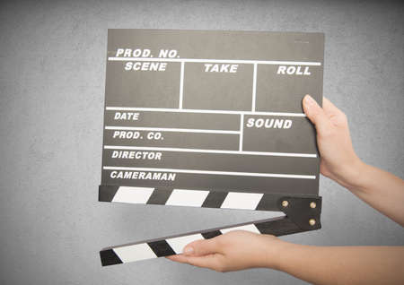 filming: Movie clapper board against gray background Stock Photo