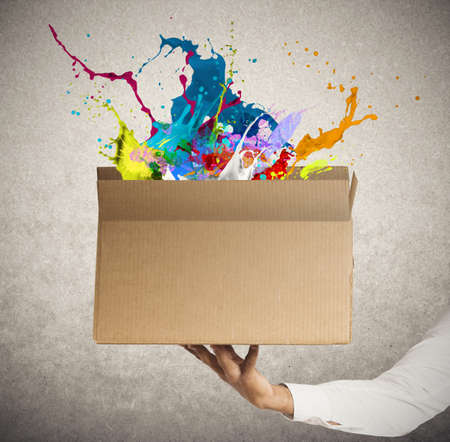 ship package: Man holding a creative business box