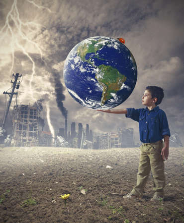Young boy holds the word. Concept of save the world photo