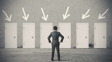 choose person: Concept of businessman choosing the right door Stock Photo