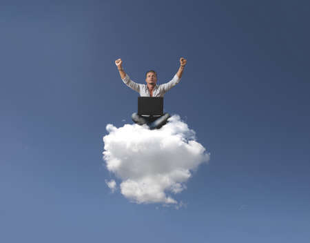Success of a businessman over a cloud photo
