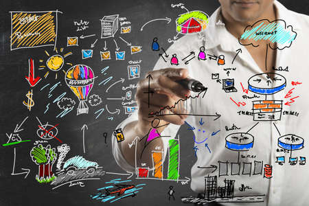 inventions: Businessman drawing a new business project