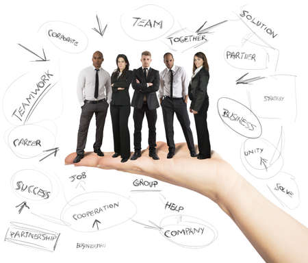 Hand holds a successful business team