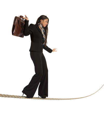 woman rope: Concept of risk in business with businesswoman on the rope