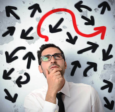 Confused businessman looking for the correct way Stock Photo - 20411742