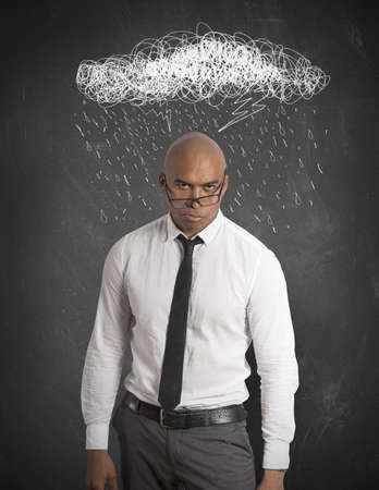 preoccupation: Stressed businessman with drawing of cloud and rain Stock Photo
