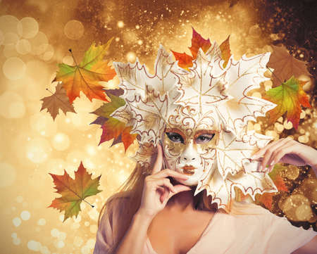 Fashion woman with autumnal carnival mask Stock Photo - 20498297