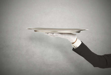 First-class service with waiter holding the tray