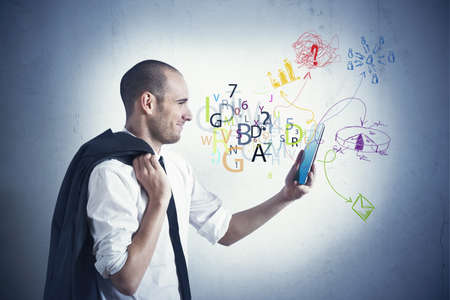 Businessman share the work with a tablet Stock Photo - 20599289