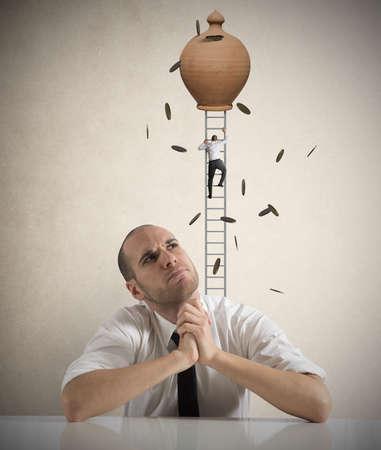 salaires: Homme d'affaires penser ? gagner Banque d'images