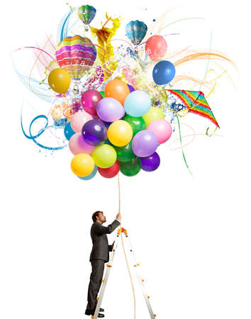 Creative businessman with colorful balloon explosion Stock Photo