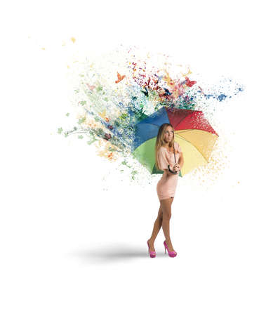 Creative fashion girl with colorful umbrella photo
