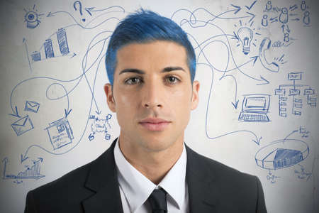 Creative businessman with blue hair and new idea photo