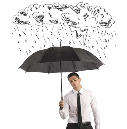 Concept of difficulty in business with umbrella photo