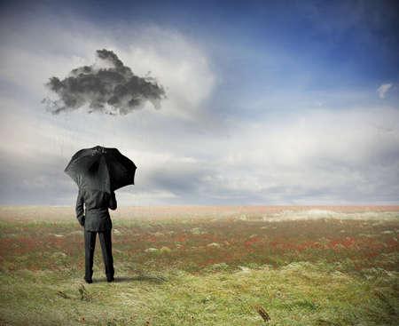 delusion: Crisis concept with businessman under a black cloud