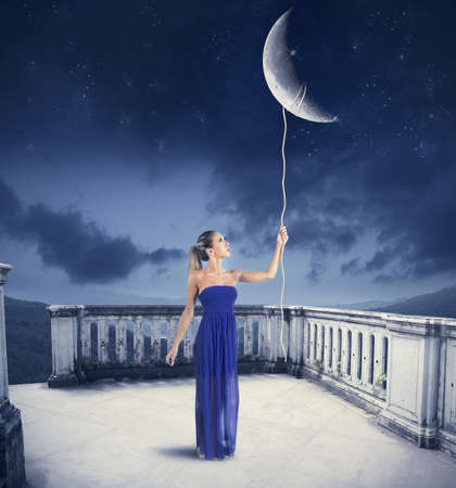 Young girl takes the Moon with rope  photo