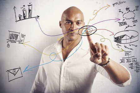 Businessman working with touch screen and moder business symbol Stock Photo - 20903875