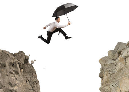 Businessman jumping over the mountains photo