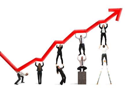 Teamwork en corporate winst met rode statistische trend Stockfoto