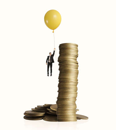 Man flying with balloon. concept of earning money Фото со стока