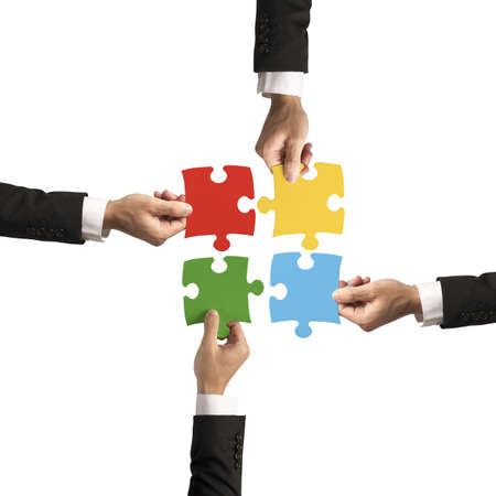 teamwork together: Teamwork and partnership concept with puzzle Stock Photo