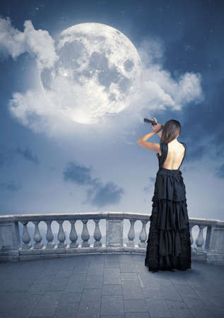 Fashion girl looks the big moon photo