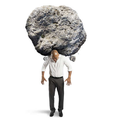 stone work: Concept of stress of a businessman with a big rock Stock Photo