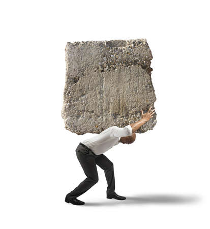 Concept of stress of a businessman with a big rock Imagens