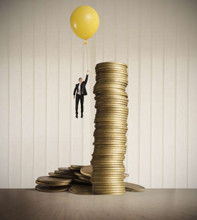 Man flying with balloon. concept of earning money photo