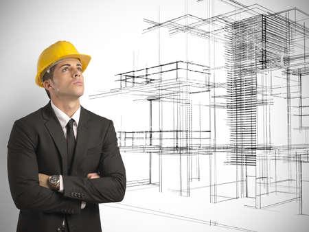 현대적인 건물의 새로운 프로젝트를 생각하는 건축가