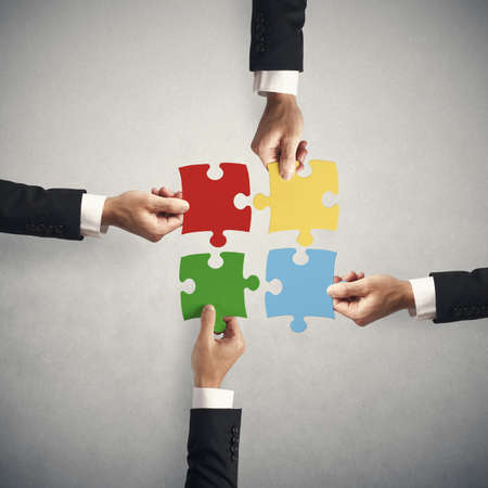 Teamwork and partnership concept with puzzle Banco de Imagens