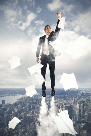 young businessman flying in the sky Stock Photo