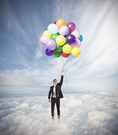 Businessman flying high concept of success Stock Photo - 21139685